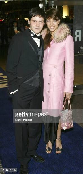 Actor Daniel Bruhl and an unidentified guest arrive at the Cinema and Television Benevolent Fund Royal Film Performance annual charity screening,...