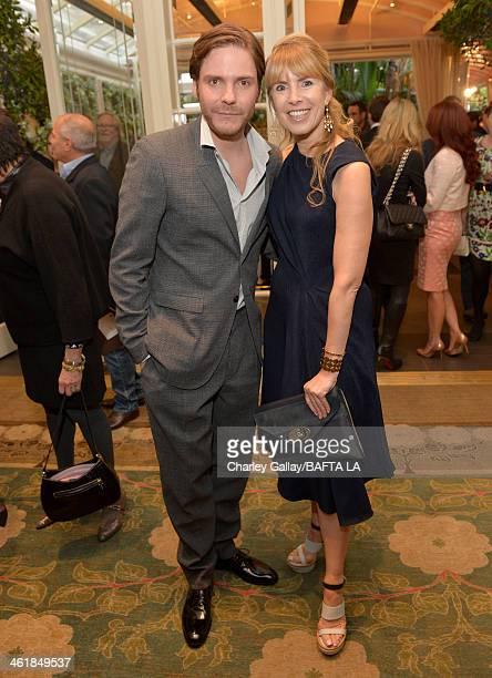 Actor Daniel Bruhl and BAFTA board member Julia Verdin attend the BAFTA LA 2014 Awards Season Tea Party at the Four Seasons Hotel Los Angeles at...