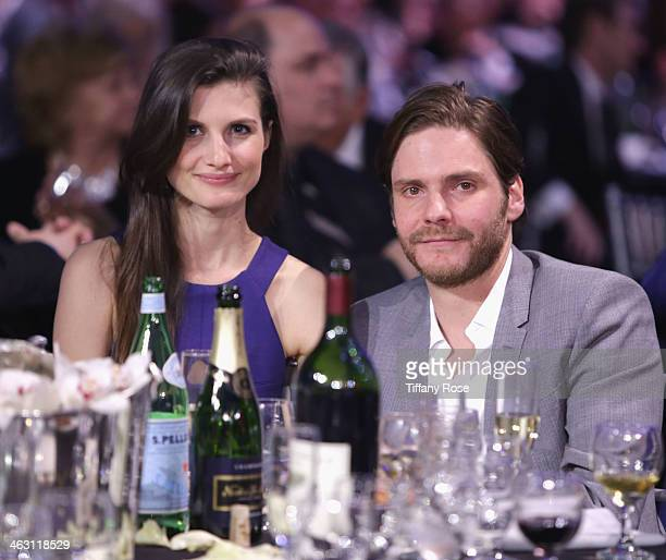 Actor Daniel Bruhl and Felicitas Rombold with Champagne Nicolas Feuillatte attend the 19th Annual Critics' Choice Movie Awards at Barker Hangar on...