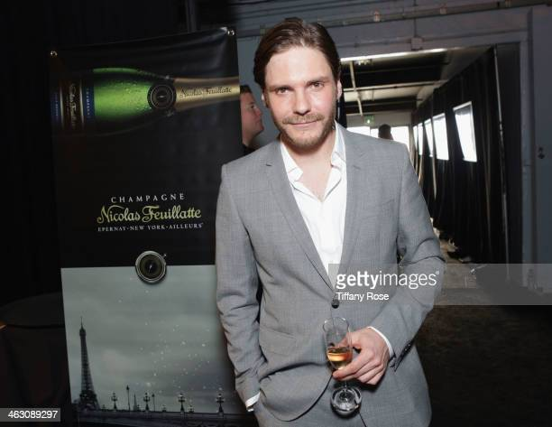 Actor Daniel Bruhl with Champagne Nicolas Feuillatte at the 19th Annual Critics' Choice Movie Awards at Barker Hangar on January 16 2014 in Santa...