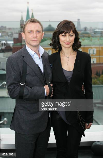 Actor Daniel Craig and actress Olga Korylenko pose during a photocall for the new James Bond film 'Quanturm Of Solace', on the roof of Ritz-Carlton...