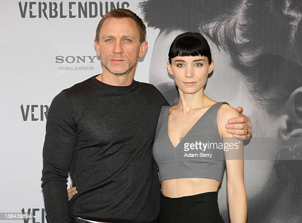 Actor Daniel Craig and actress Rooney Mara pose at the photocall of the film 'The Girl With the Dragon Tattoo' the first part of a series of film...