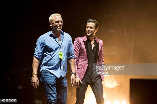 Actor Daniel Craig and musician Brandon Flowers of The Killers perform at Piedmont Park on September 18 2016 in Atlanta Georgia