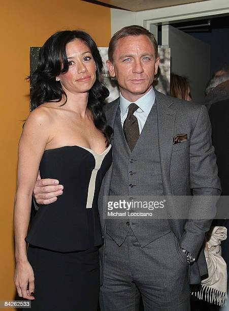 Actor Daniel Craig and Satsuki Mitchell attend the Cinema Society and Nextbook screening of Defiance at the Landmark's Sunshine Cinema on January 12...