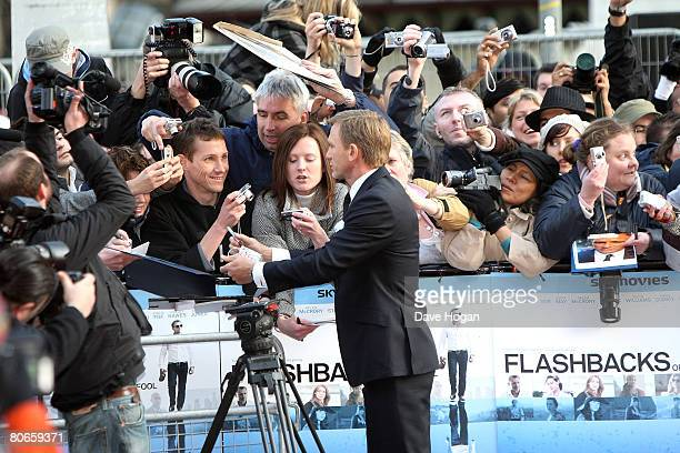 Actor Daniel Craig greets fans at the UK premiere of 'Flashbacks of a Fool' at the Empire cinema Leicester Square on April 13 2008 in London England