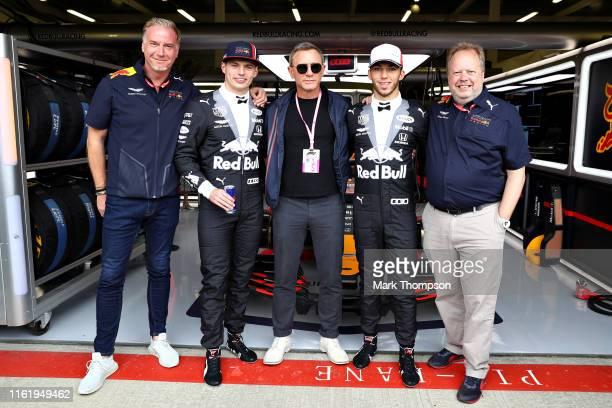 Actor Daniel Craig poses for a photo with Marek Reichman Executive Vice President Chief Creative Officer Aston Martin Lagonda Ltd Max Verstappen of...