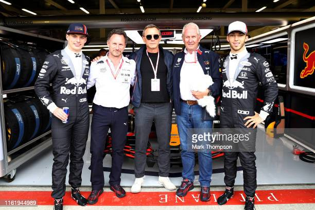 Actor Daniel Craig poses for a photo with Max Verstappen of Netherlands and Red Bull Racing Pierre Gasly of France and Red Bull Racing Red Bull...