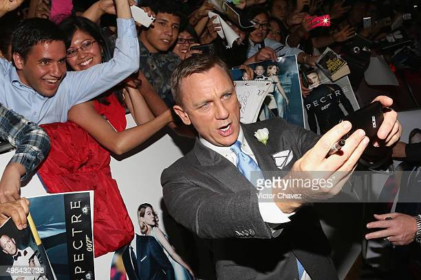 Actor Daniel Craig signs autographs and takes selfies with fans during the 'Spectre' Mexico City premiere at Auditorio Nacional on November 2 2015 in...