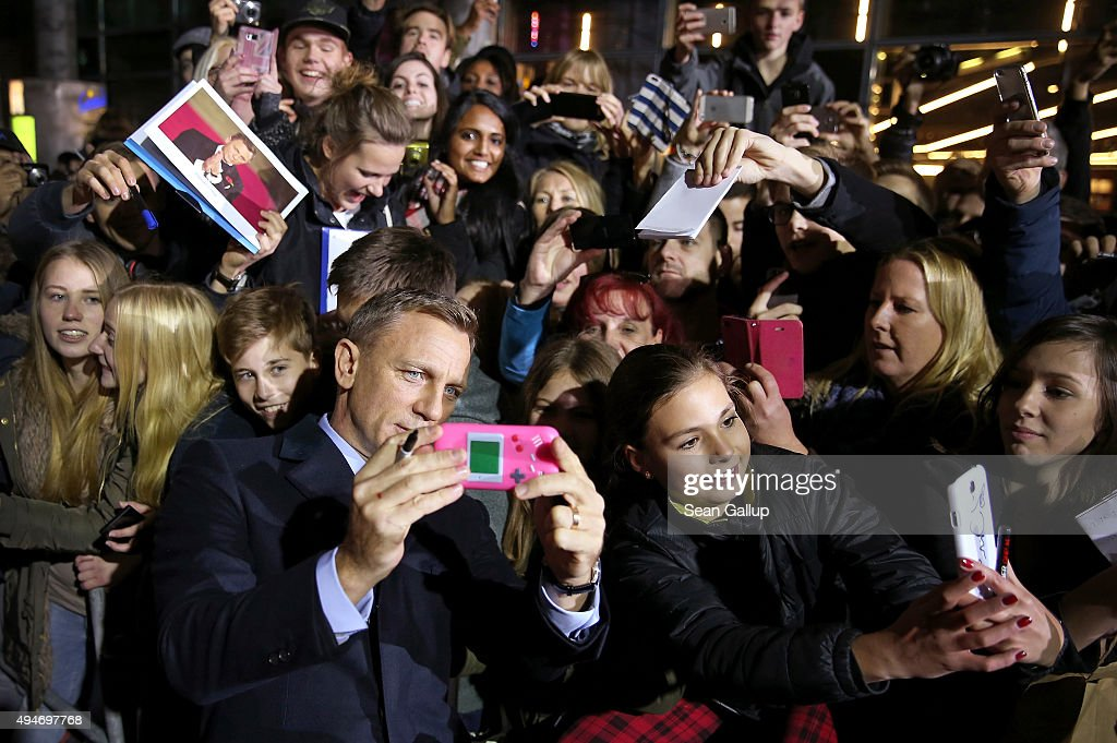 Actor Daniel Craig takes a selfie with fans as he attends the German premiere of the new James Bond movie 'Spectre' at CineStar on October 28, 2015 in Berlin, Germany.