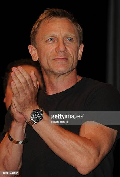 Actor Daniel Craig walks onstage at the 'Cowboys Aliens' panel discussion during ComicCon 2010 at San Diego Convention Center on July 24 2010 in San...