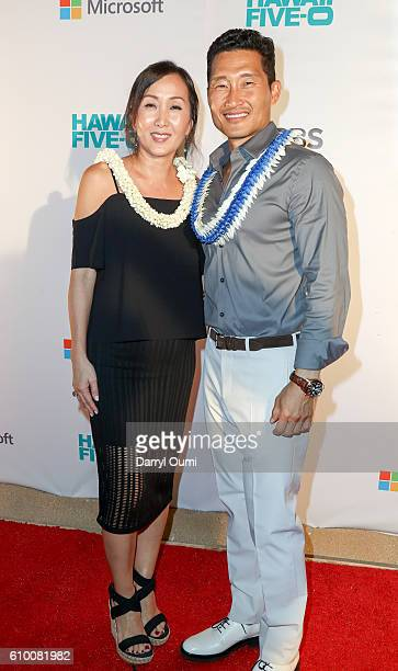 Actor Daniel Dae Kim and his wife Mia arrive at the CBS 'Hawaii Five0' Sunset On The Beach Season 7 Premier Event at Queen's Surf Beach on September...
