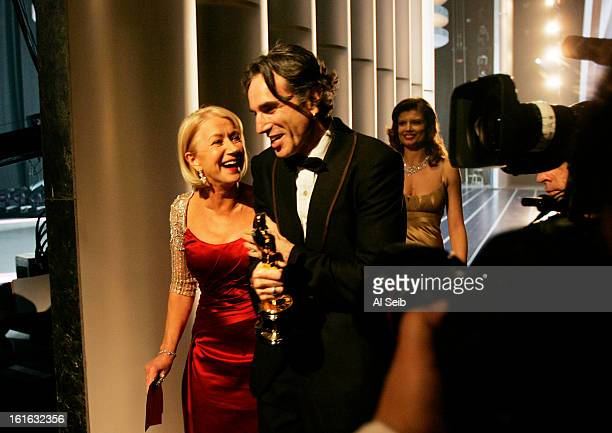 Actor Daniel Day Lewis is photographed backstage at the 80th Annual Academy Awards with actress Helen Mirren after winning for Best Performance by an...