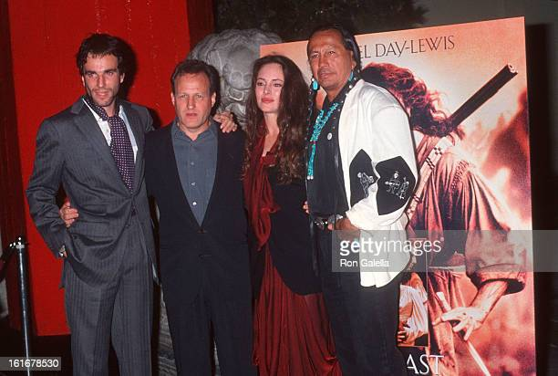 Actor Daniel DayLewis director Michael Mann actor Russell Means and actress Madeleine Stowe attend 'The Last of the Mohicans' Hollywood Premiere on...