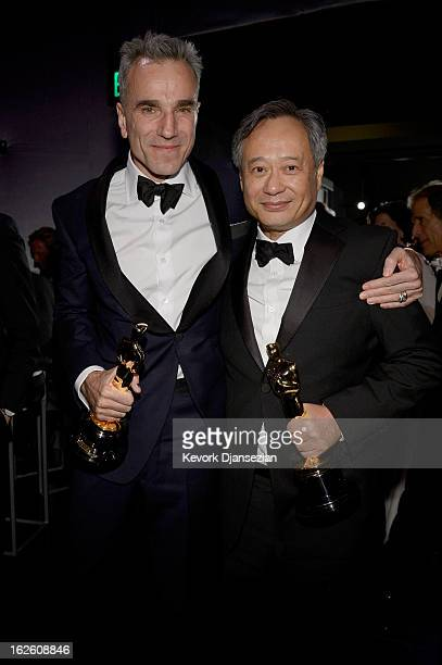 Actor Daniel DayLewis holds his trophy for Best Actor for 'Lincoln' and director Ang Lee holds his Best Director trophy for ' Life of Pi' as they...