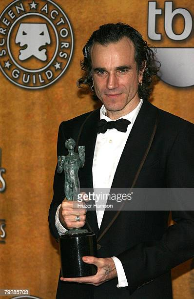 "Actor Daniel Day-Lewis poses with the Outstanding Performance by a Male Actor in a Leading Role award for ""There Will Be Blood"" in the press room..."
