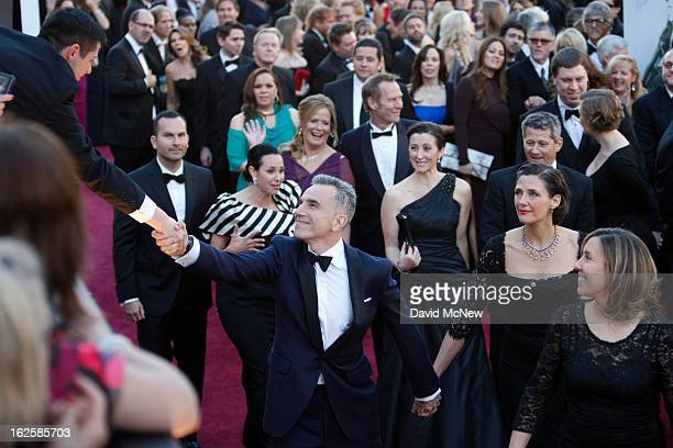 Actor Daniel DayLewis shakes hands with a fan as he walks the red carpet at the 85th Annual Academy Awards at the Hollywood Highland Center on...
