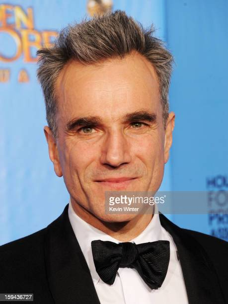 """Actor Daniel Day-Lewis, winner of Best Actor in a Motion Picture for """"Lincoln,"""" poses in the press room during the 70th Annual Golden Globe Awards..."""