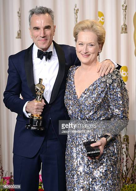 Actor Daniel DayLewis winner of the Best Actor award for Lincoln and presenter Meryl Streep pose in the press room during the Oscars held at Loews...