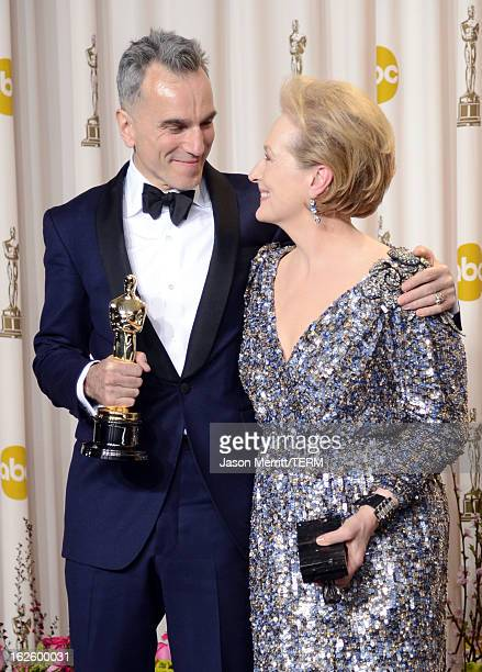 Actor Daniel DayLewis winner of the Best Actor award for 'Lincoln' and presenter Meryl Streep pose in the press room during the Oscars held at Loews...