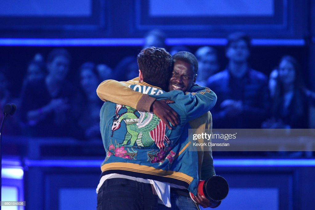 Actor Daniel Kaluuya (R) accepts the Next Generation award for 'Get Out' from actors John Cena and Aaron Taylor-Johnson onstage during the 2017 MTV Movie And TV Awards at The Shrine Auditorium on May 7, 2017 in Los Angeles, California.