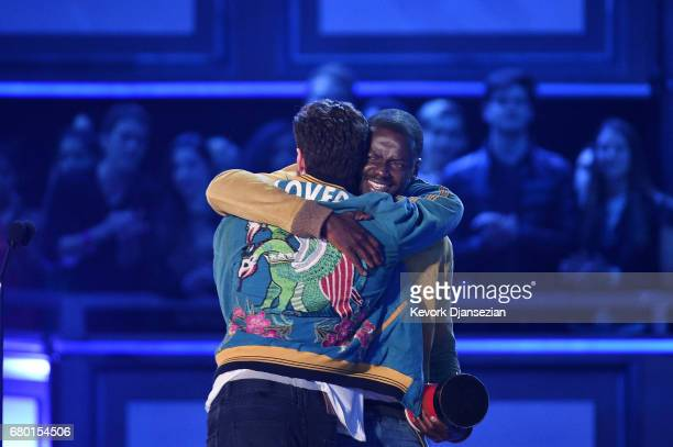 Actor Daniel Kaluuya accepts the Next Generation award for 'Get Out' from actors John Cena and Aaron TaylorJohnson onstage during the 2017 MTV Movie...