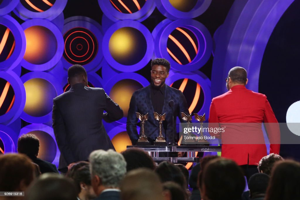 Actor Daniel Kaluuya (L) and writer/director Jordan Peele (R) walk onstage to accept Best Feature for 'Get Out' from actor Chadwick Boseman (C) onstage during the 2018 Film Independent Spirit Awards on March 3, 2018 in Santa Monica, California.