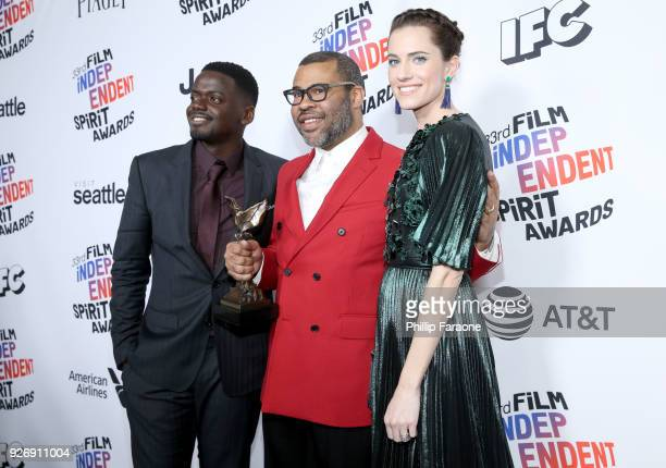 Actor Daniel Kaluuya, director Jordan Peele and actor Allison Williams, winners of Best Feature for 'Get Out', pose in the press room during the 2018...