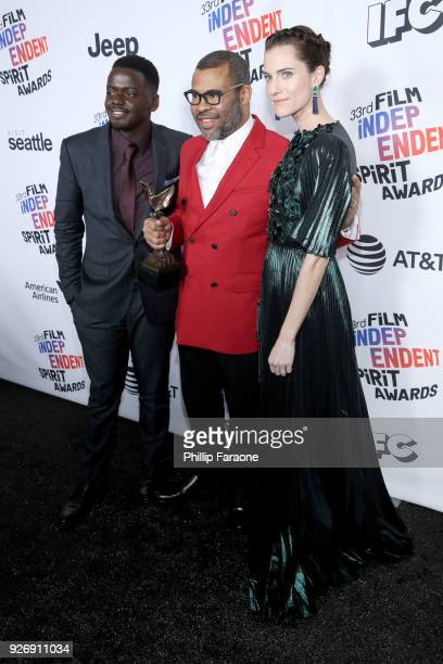 Actor Daniel Kaluuya director Jordan Peele and actor Allison Williams winners of Best Feature for 'Get Out' pose in the press room during the 2018...