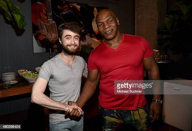 Actor Daniel Radcliffe and professional boxer Mike Tyson attend the Getty Images Portrait Studio Powered By Samsung Galaxy At ComicCon International...