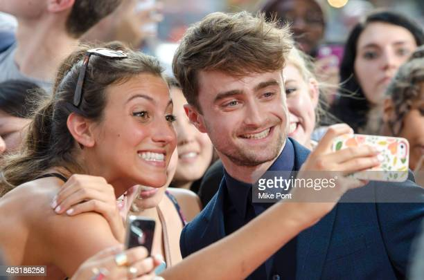 Actor Daniel Radcliffe poses for a selfie with a fan at the What If New York Premiere at Regal EWalk 13 on August 4 2014 in New York City