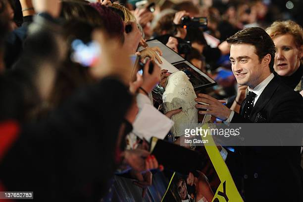 Actor Daniel Radcliffe signs autiographs as he attends 'The Woman In Black' World Film Premiere at the Royal Festival Hall on January 24 2012 in...