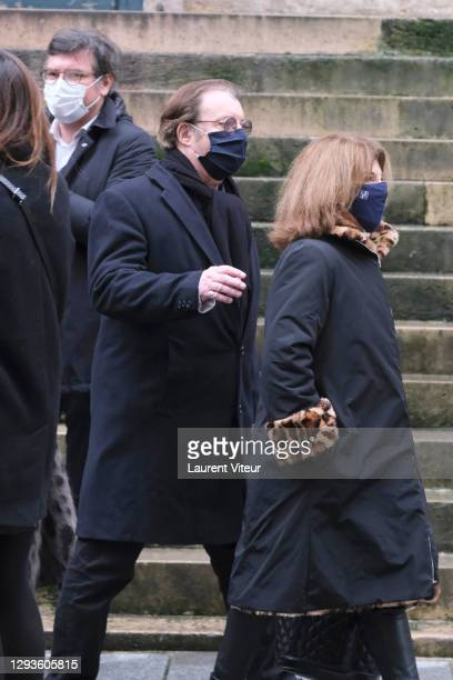 Actor Daniel Russo and actress Actress Nicole Calfan attend Claude Brasseur's funeral at Saint Roch Church on December 29, 2020 in Paris, France.