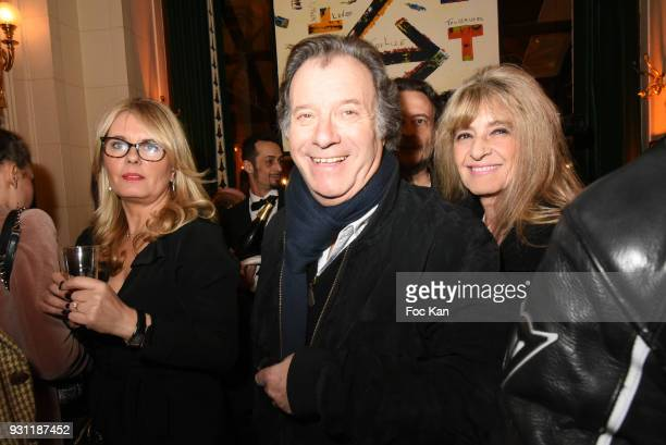 Actor Daniel Russo and his wife Lucie Russoe attend Marc Cerrone Exhibition Preview at Deux Magots on March 12 2018 in Paris France