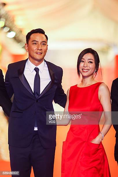 Actor Daniel Wu and actress Zhang Jingchu walk the red carpet of the 19th Shanghai International Film Festival at Shanghai Grand Theatre on June 11...
