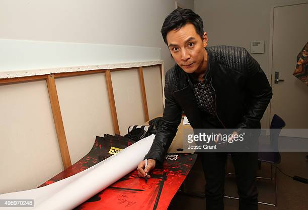 Actor Daniel Wu signs a poster at AMC and CAPE Celebrate 'Into The Badlands' at the Japanese American National Museum on November 5 2015 in Los...