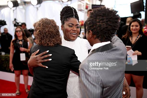 Actor Danielle Brooks hugs actos Gaten Matarazzo and Caleb McLaughlin at The 23rd Annual Screen Actors Guild Awards at The Shrine Auditorium on...