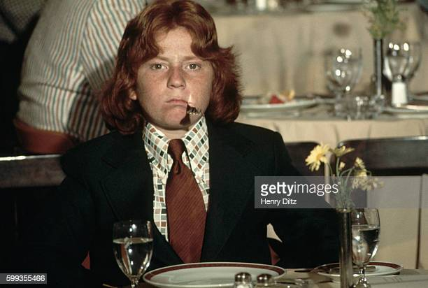 Actor Danny Bonaduce puts a fork in his mouth at dinner on the cruise ship Fairseas during filming of an episode of The Partridge Family | Location...