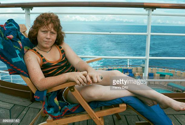 Actor Danny Bonaduce relaxes in a deck chair on the cruise ship Fairseas during filming of an episode of The Partridge Family | Location Near...