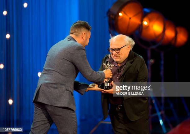 US actor Danny de Vito receives the Donostia award from Spanish director Juan Antonio Bayona at the 66th San Sebastian Film Festival in the northern...