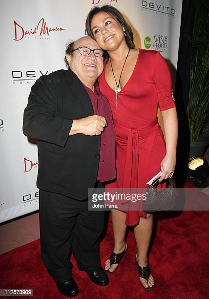 Actor Danny DeVito and Chef Rachael Ray pose at the 'Fettuccini Fiorentina' event at DeVito South Beach on February 23 2008 in Miami Beach Florida