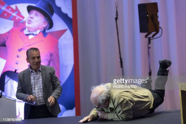 Actor Danny DeVito falls as he arrives for a press conference to present Tim Burton's Dumbo movie in Mexico City, on March 5, 2019.