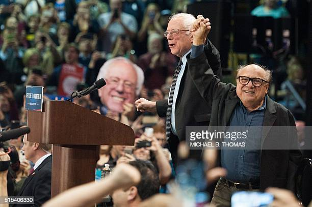 Actor Danny DeVito introduces Democratic Presidential candidate Bernie Sanders at a 'Future to Believe In' rally at Afton High School on March 13...