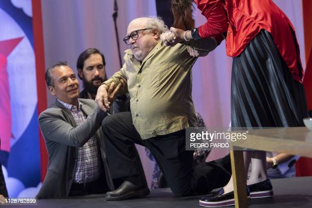 Actor Danny DeVito is assisted after falling before a press conference to present Tim Burton's Dumbo movie in Mexico City, on March 5, 2019.