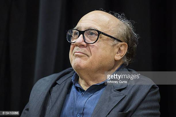 Actor Danny DeVito listens to Democratic presidential candidate Bernie Sanders speak at a campaign rally on March 13 2016 in St Louis Missouri...