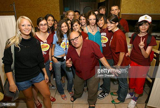 Actor Danny DeVito poses with student jurors at a dinner at Divina Commedia during the Giffoni Film Festival on July 17, 2007 in Giffoni, Italy.