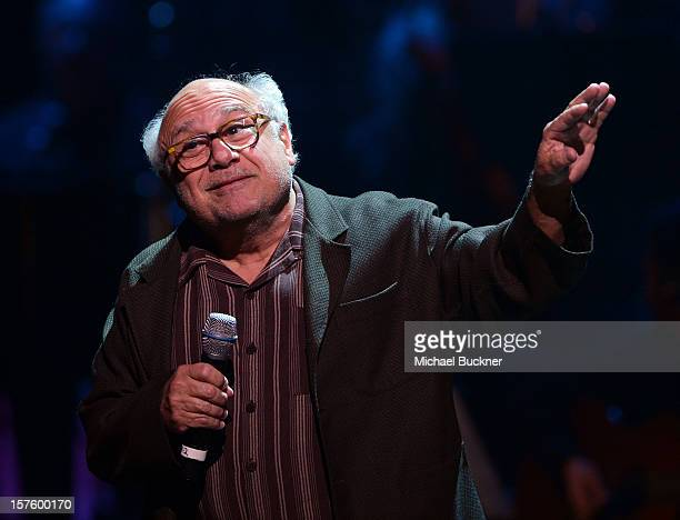 Actor Danny DeVito speaks onstage during a celebration of Carole King and her music to benefit Paul Newman's The Painted Turtle Camp at the Dolby...