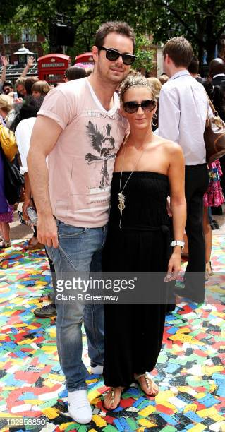 Actor Danny Dyer and partner Joanne Mas arrive at the UK premiere of 'Toy Story 3' at Odeon Leicester Square on July 18 2010 in London England