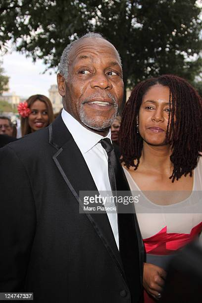 Actor Danny Glover and Asake Bomani arrive at the 6th edition of the AfroCaribbean Arts Awards at Theatre du Chatelet on September 12 2011 in Paris...