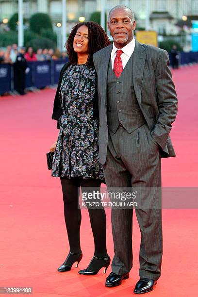 US actor Danny Glover and his wife Asake Bomani hit the red carpet before a homage ceremony during the 37th US Film Festival in Deauville...