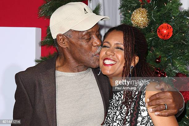 Actor Danny Glover and his Wife Elaine Cavalleiro attend the premiere of 'Almost Christmas' at Regency Village Theatre on November 3 2016 in Westwood...